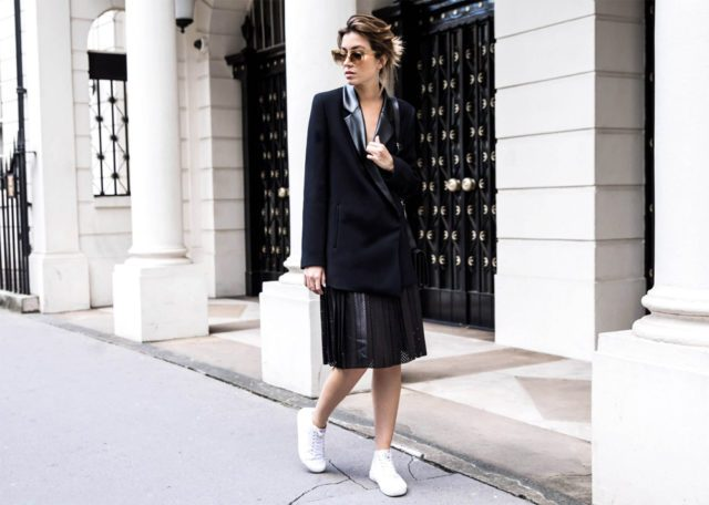 With black blazer and white sneakers