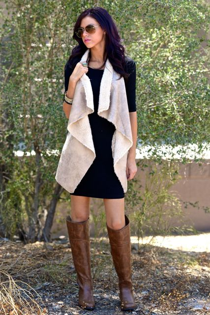 With black dress and brown high boots