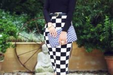 With black fitted shirt, printed clutch and black pumps