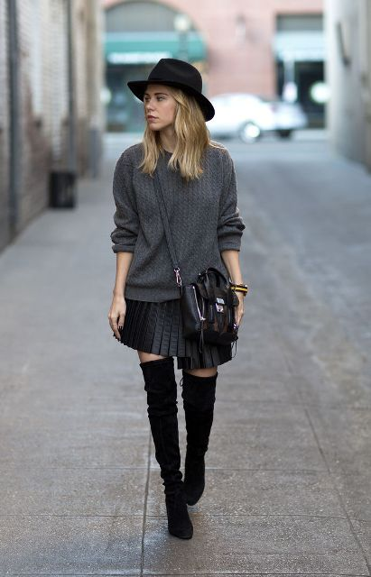 With black hat, gray sweater, black crossbody bag and over the knee boots