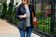 With black jacket, brown tote, jeans and red high boots