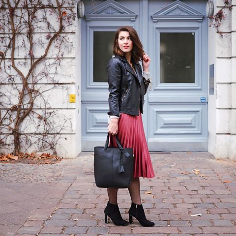 With black leather jacket, ankle boots and tote