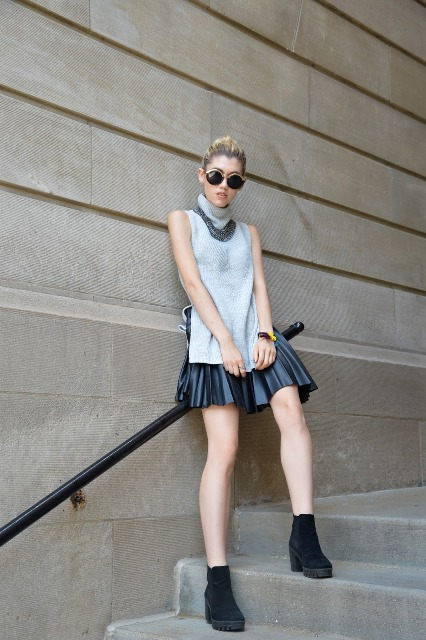 With black leather mini skirt, necklace and black suede boots