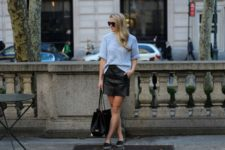 With black leather skirt, black tote and flat shoes