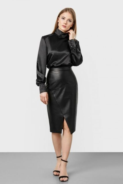 With black leather wrap knee-length skirt and high heels