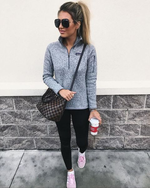 With black leggings, white and pink sneakers and printed bag