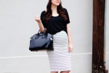 sporty outfit with a striped skirt and a pair of sneakers