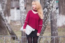With black mini skirt, fur clutch, black tights and embellished boots