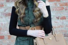 With black off the shoulder shirt, pleated skirt and beige bag