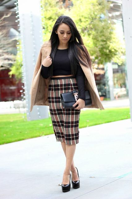 With black shirt, beige blazer, clutch and platform shoes