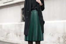 With black shirt, black coat and gray high boots
