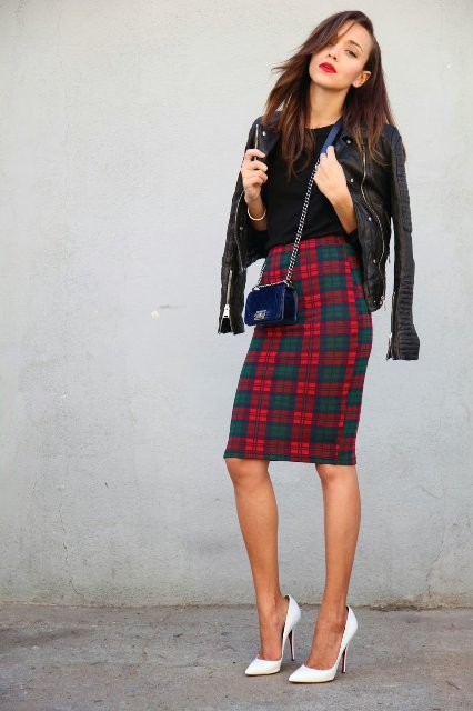 With black shirt, black leather jacket, navy blue mini bag and white high heels