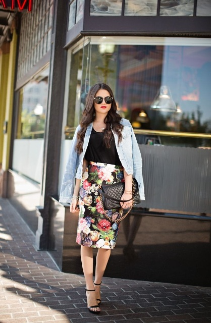 With black top, denim jacket, high heels and black bag
