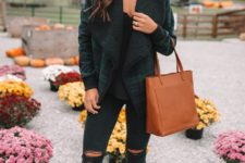 With black top, distressed skinny pants, brown leather ankle boots and brown leather tote