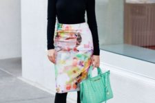 With black turtleneck, black tights, black shoes and mint green bag