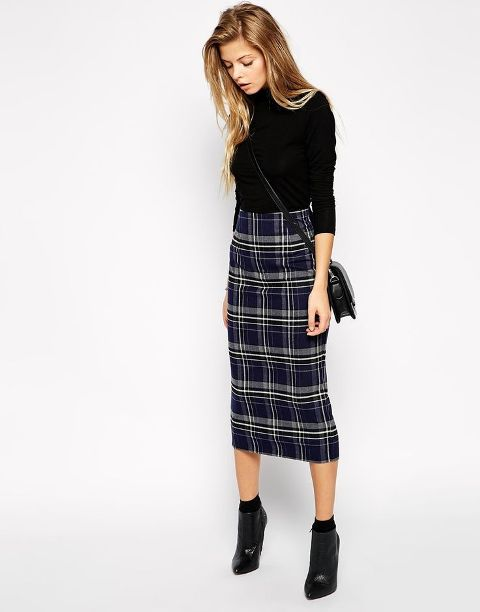 a monochromatic turtleneck with a checked skirt is an awesome combo