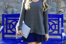With blue skater skirt and pastel colored clutch