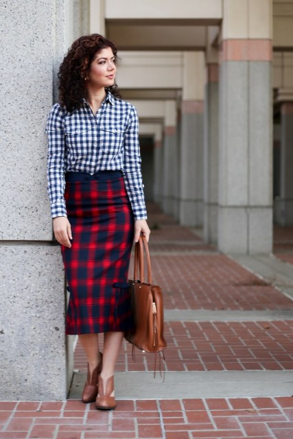 With checked button down shirt, brown bag and brown shoes