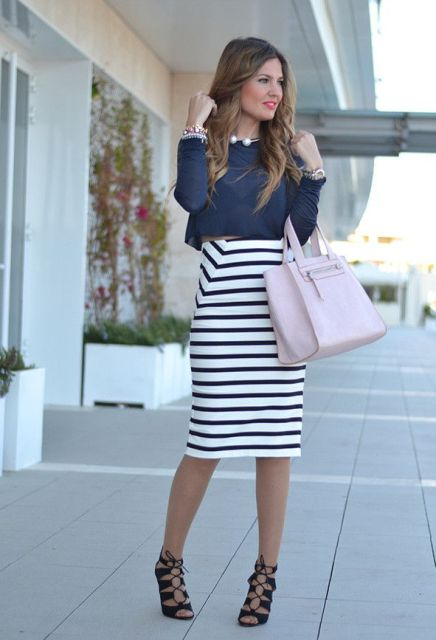 With crop shirt, pale pink bag and lace up shoes