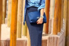 With denim shirt, clutch, printed cardigan and navy blue pumps