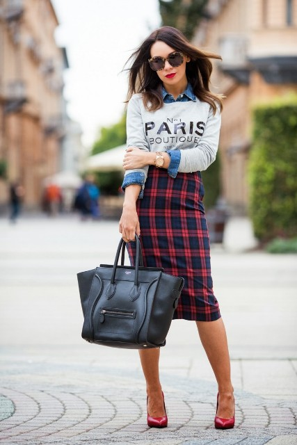 With denim shirt, labeled shirt, red pumps and black tote
