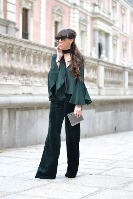 With emerald ruffled blouse, sunglasses and mini clutch
