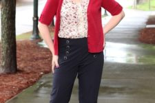 With floral blouse, navy blue trousers and beige flat shoes