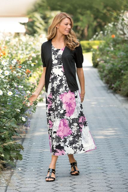 With floral maxi dress and black flat shoes