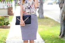 With floral t-shirt, black clutch and beige shoes