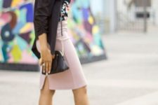 With floral top, pale pink skirt, bag and high heels