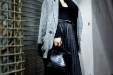 With gray coat, black leather bag, black shirt and boots