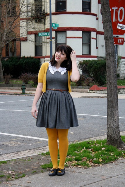 With gray dress, belt, yellow tights and black shoes