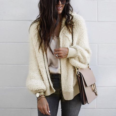 With gray jeans, beige bag and white loose shirt