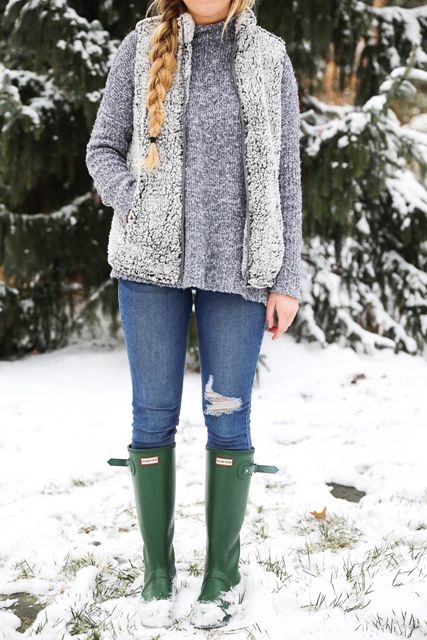 With gray loose sweater, skinny jeans and green high boots
