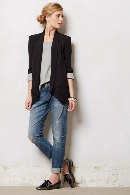 With gray loose sweatshirt, cuffed jeans and flat shoes