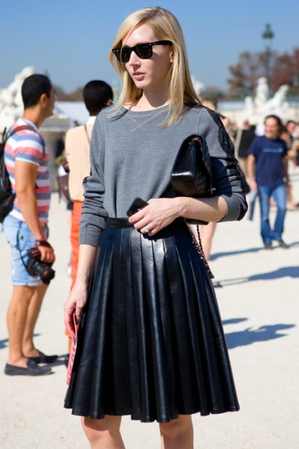 With gray sweatshirt and black clutch