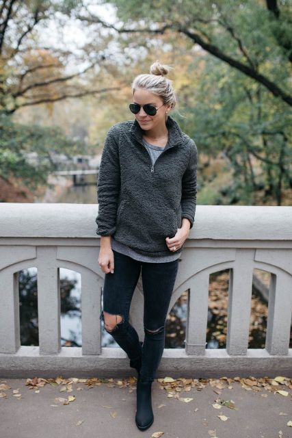 With gray t-shirt, distressed pants and ankle boots