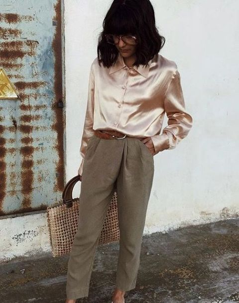 With gray trousers, brown belt and tote
