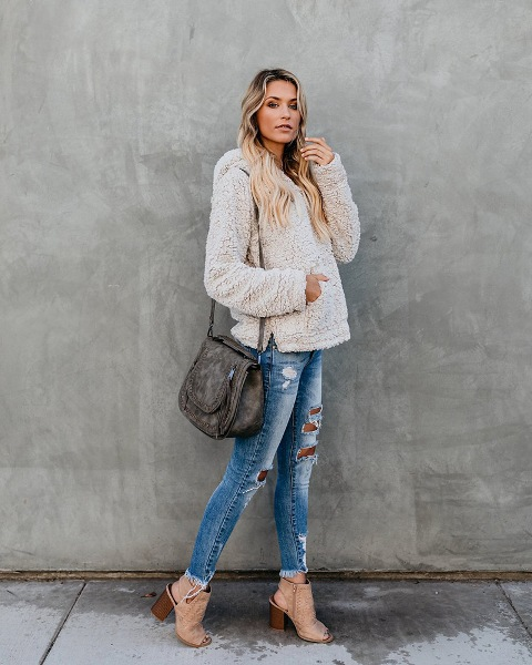 With jeans, gray bag and cutout boots