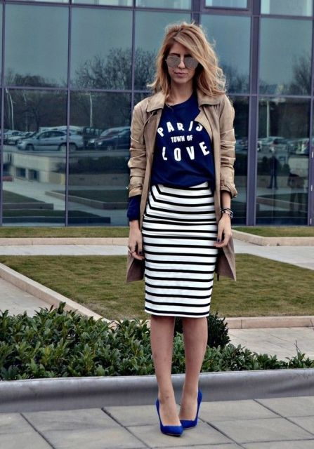 With labeled t shirt, beige trench coat and blue pumps