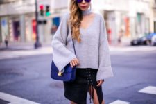 With lace up skirt and blue small bag
