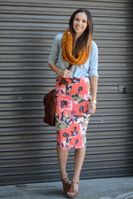 With light blue shirt, orange scarf, brown bag and platform shoes