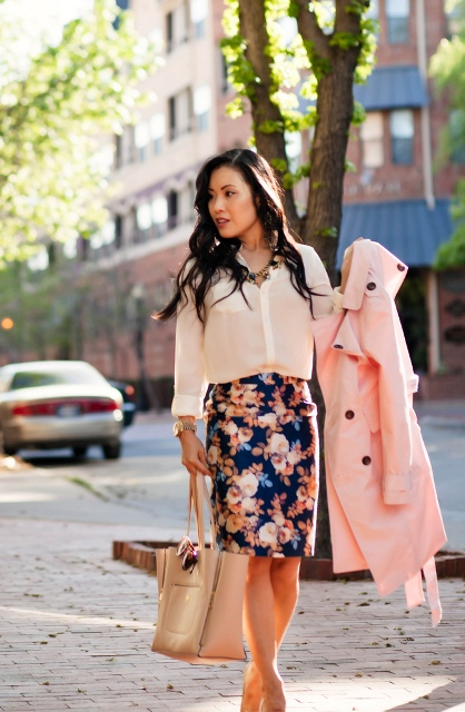 With loose button down shirt, heels, pale pink coat and beige bag