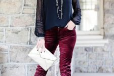 With navy blue lace blouse, black shoes and white clutch