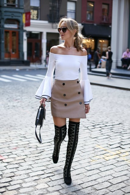 With off the shoulder blouse, over the knee boots and small bag