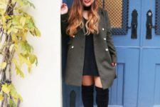 With olive green coat and black over the knee boots