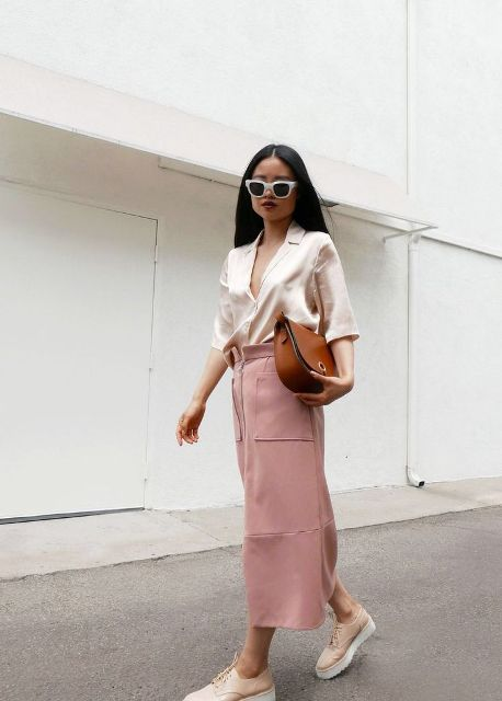 With pale pink midi skirt, brown bag and platform shoes
