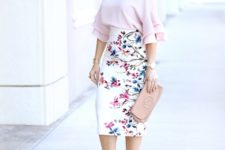 With pale pink ruffled blouse, clutch and pumps