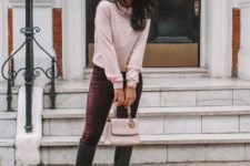 With pale pink shirt, black high boots and pale pink bag