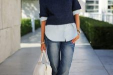 With pastel colored shirt, cuffed jeans, white bag and metallic shoes
